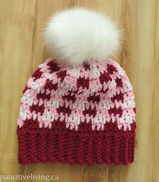 red, pink and white crocheted plaid hat with pom pom