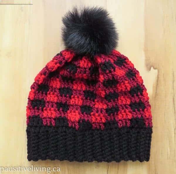Red and Black plaid hat with black pom pom