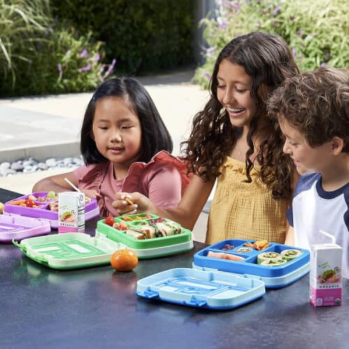 Kids eating lunch from a Benito Lunchbox